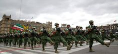 Mexican military policemen marching down the Zócalo in Mexico City at the 2014 Mexican Independence Day Parade.