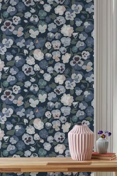 Pretty pansy flowers in shades of blue with blush and lemon highlights feature on this lovely Lorna Syson wallpaper pattern.