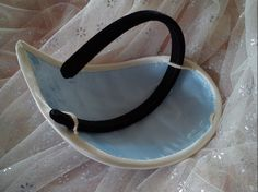 Teardrop attached to headband. Not a fan of the actual shape, but of the construction.