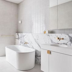 hotel style A heavily veined marble slab, mosaic wall tiles and brushed-brass accessories are a luxe touch in this white bathroom. Next Bathroom, White Bathroom, Modern Bathroom, Small Bathroom, Vanity Bathroom, Budget Bathroom, Marble Bathrooms, Bathroom Cabinets, Hotel Bathrooms