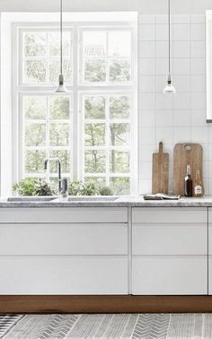 ComfyDwelling.com » Blog Archive » 83 Adorable Scandinavian Kitchen Design Ideas Smooth move to do toe kick in walnut to contrast with cabinetry.