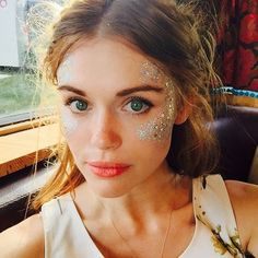 Glitter face in the woods.