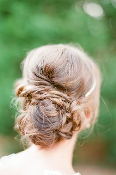 Twisted messy bun, Bride #hair  Photography: Brklyn View Photography - www.brklynview.com  Read More: http://www.stylemepretty.com/2014/06/24/autumn-barn-wedding-in-the-hamptons/