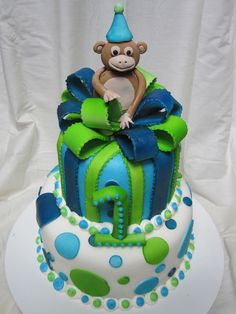https://flic.kr/p/a2Y57D | First birthday boy cake | First birthday boy cake with lime green, light blue and dark blue polka dots and present second tier with bow and little monkey on top.