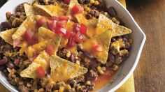 Start with classic nacho ingredients and blend them with ground beef and easy canned corn and peppers for a quick skillet supper.