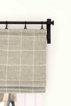 Cosy soft wool blinds work perfectly with the clean lines of a hand-forged curtain pool set. #hygge