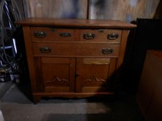 Very Early 1900's Sideboard solid oak with original laced pulls. SOLD
