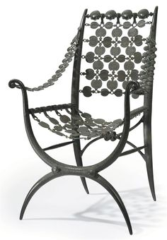 ARMAND ALBERT RATEAU (1882-1938) A Patinated Bronze Armchair, circa 1919-20 model no. 1793, from the Blumenthal commission 35 5/8 in. (90.4 cm.) high, 24 in. (62.8 cm.) wide, 19 in. (50.2 cm.) deep one leg stamped A.A. Rateau INVR, the other stamped A.A. Rateau INVR 86 Paris 1793
