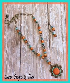 July / August Choxie Challenge .. A B'sue Choxie stamping along with a free cab, eautiful orange and turquoise beads, turquoise rhinestones and brass chain make up this necklace set .. Clever Designs by Jann .. https://www.etsy.com/shop/CleverDesignsbyJann