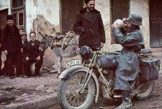 A German motorcyclist drinks wine in a Bulgarian village...