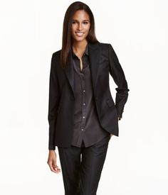 Black. PREMIUM QUALITY. Single-breasted blazer in wool twill. Chest pocket, welt front pockets with flap, and decorative buttons at cuffs. Vent at back.