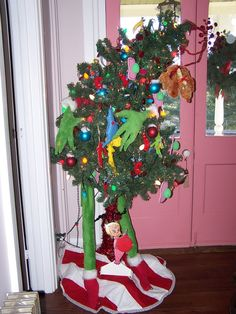 Grinch hands and feet around tree. So funny and easy to create!