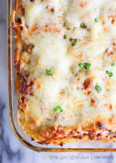 This Baked Spaghetti is a dressed up version of spaghetti perfect for a potluck or for bringing in to a family for dinner. the-girl-who-ate-everything.com