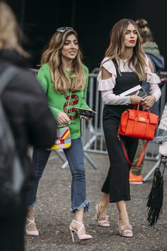 Always a treat to see a few of our favourite bloggers at Fashion Week. Amelia Liana and Lydia Elise Millen showing us how street style is done on Day 2 at Topshop Unique Show. Photo by Suzi Oven for Maxwell Scott