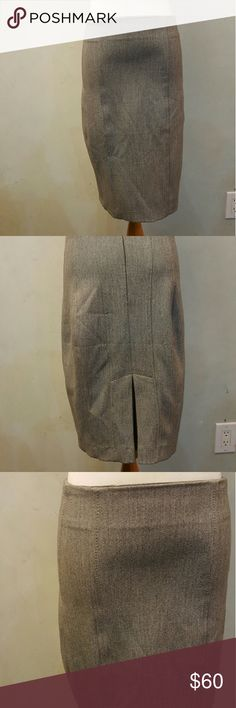 Express grey pencil skirt Express grey pencil skirt with a flear back. In perfect condition like new. Express Skirts Pencil