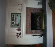 ...this is the AFTER picture of the big ugly fireplace.  Looks nice!  A little more formal than our style - but what a great idea.
