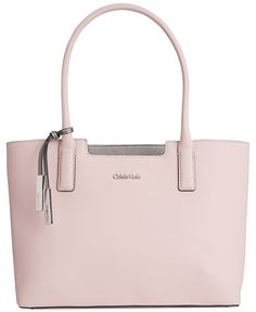 You can't go wrong with a classic, and this Calvin Klein leather tote handles it all effortlessly with a simple divided interior and modern shape. Calvin Klein Handbags, Calvin Klein Bags, Stylish Handbags, Purses And Handbags, Beautiful Handbags, Cute Purses, Luxury Bags, Handbag Accessories, Mini Bag