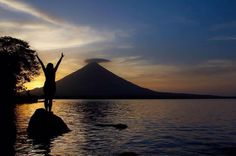 """11 UnbelievableYogaSpots for Asana Indulgence Worldwide @trover: """" 6. Get your Palm Tree Pose energized by practicing in front of live volcanoes – like this gorgeous spot off the coast of Isla Ometepe, Nicaragua."""""""