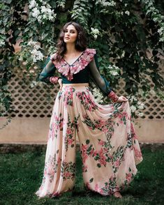 Gorgeous blush pink color layered lehenga and bottle green color crop top with rich hand embroidery work. Lehenga with floral print. Party Wear Indian Dresses, Designer Party Wear Dresses, Indian Gowns Dresses, Kurti Designs Party Wear, Indian Designer Outfits, Indian Outfits, Bridal Dresses, Lehnga Dress, Lehenga Choli