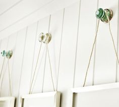 Love this decorating idea of using door knobs to hang pics. (Vintage Glass Frame Hangers   Pottery Barn)