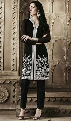 Stand out in the crowd wearing this black color georgette embroidered tunic. This attire is effectively designed with lace and resham work. #georgettekurtis #georgettetunic #blackembroideredtunics
