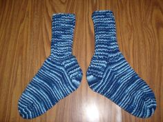 Here is a wonderful pair of hand knit adult size socks. Heel to toe is approx. 9 1/2 in. and the ribbing on the top (top to ankle) is approx. 6 1/2 in. The color yarn used is called Shaded Dusk which is a multi- colored yarn that consists of several different shades of blue. These socks are made of 100% acrylic yarn and can be machine washed and dried.