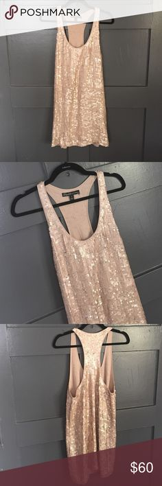 ELIZABETH & JAMES SEQUIN DRESS Size 4. Sequin with pockets like new. Flawless all sequins in tact Elizabeth and James Dresses