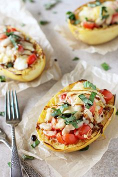 Recipe for caprese stuffed spaghetti squash. Spaghetti squash infused with basil and garlic, then filled with cherry tomatoes and mozzarella! Finished with balsamic glaze!