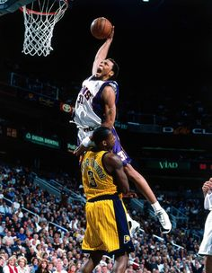 """The """"Matrix"""" Shawn Marion explodes for a dunk in the Phoenix Suns' white home uniform."""