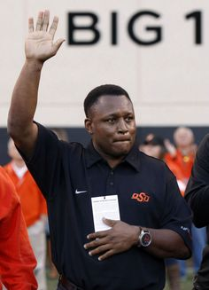 OSU's Barry Sanders is honored at the game against Kansas in Stillwater, OK, Nov. 9, 2013. STEPHEN PINGRY/Tulsa World