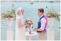 Spring destination wedding in the Greece. Wedding ceremony on terrace by the sea at Seaside Restaurant wedding venue Lefkada Greece