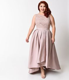 This modest high low mocha plus size dress is shorter in the front and longer in the back. The dress falls mid length and is sleeveless with a lace bodice and illusion neckline. The skirt is pleated with a 2 inch waistband that ties in the back.