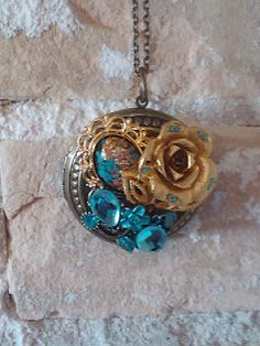 Blue Buy You.  Brass locket with a collage of vintage broken jewelry pieces.