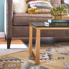 Update an existing coffee table with just a can of spray paint. A can of metallic gold spray paint spruces up this formerly black-metal-and-glass coffee table. The metallic finish instantly gives furniture with good lines a fashion-forward look.