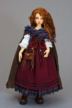 This costume wasdesigned to fit my lovely Narae by Narindoll. It was inspired by a costumeI made many years ago for the heroine of the Scottish legend Tam Lin.