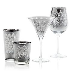 Puccini Glassware, a bright reflective metallic glassware that is intricately etched and the silver exterior is cleverly paired with a Silver interior, supported on a clear glass stem. Hand wash only.