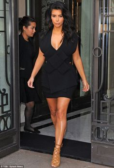 Seal of approval: Kim Kardashian stepped out wearing her new favourite label A.W.A.K.E in Paris on Sunday, the second time in four days she has worn the brand