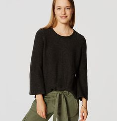 Subtle bell sleeves give this super smooth knit a totally mod ring. Round neck. 3/4 bell sleeves.