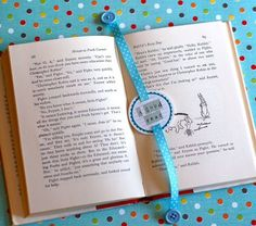 The possibilities are endless with this bookmark.   Have the ribbon go through a vintage valentine, red ribbon and heart buttons on the end.