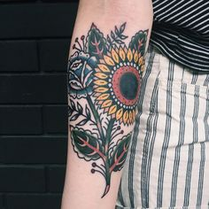 """""""Sunflower with a little cover up on Iida, all the way from Finland!! Thanks so much! It was a pleasure to tattoo you ✨"""""""