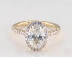 1.5ct Halo Oval Engagement Ring Yellow Gold