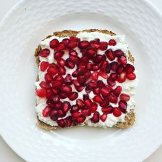 Today's #healthybreakfast : #lowfat #cottagecheese on #ezekielbread with #pomegranate seeds. Did you know they are great for #healthyskin and #antiaging ? They add a nice #crunch too. Happy 2016! #antioxidants #fiber #protein