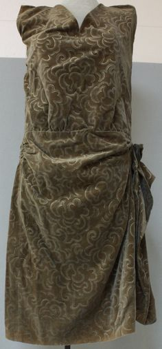 This Dress From the Mid 1800's was Donated By Jack Treleaven. This Dress Is Made From A Beautiful Brown/Green Velvet With A Scroll and Flower Design in Gold. The Dress Appears to Have Been Altered At Some Point Though, As it Has Been Hemmed To Roughly Represent A Dress That May Have Been Worn in the Late 1920's to 1930's. Green Velvet, Flower Designs, Beautiful Women, Brown, Womens Fashion, Gold, How To Wear, Dresses, Flower Drawings