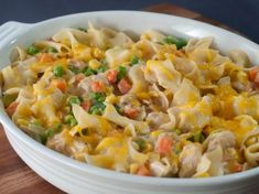 Add a seafood option to your casserole arsenal. Salmon, vegetables and noodles come together under melty cheddar cheese.