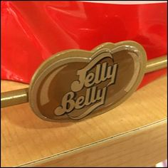 Open Wire surrounds each shelf of this Jelly Belly Serpentine Tower. Upper levels are embellished with Jelly Belly Jelly Bean Branded Productstop Details Jelly Belly, Logo Branding, Beans, Retail, Candy, Beans Recipes, Sweets, Candy Bars, Sleeve
