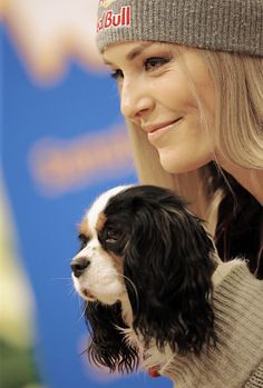 Lindsey Vonn of USA with her dog Lucy at a press conference during the Audi FIS Alpine Ski World Cup Women's Downhill Training on January 12, 2017 in Altenmarkt/Zauchensee, Austria