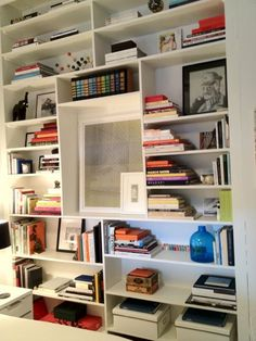 This shelving, in friend's Joey & Jackie's apartment, directly inspired the built in library shelving / tv / desk unit, I am customizing for the TV room
