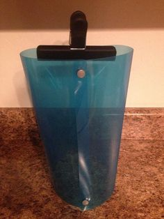 DIY Diaper Sprayer Shield ~ I would guess you'd want a large capacity binder to have enough room to easily spray down the whole diaper. I think I'd want a larger opening like this one: http://spray-pal.com/productvideo.html.