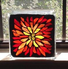 Finished up a few more glass blocks this weekend...I have been LOVING doing these blocks! I've got them all lined up on my windowsill right now, and I must say it's quite colorful.