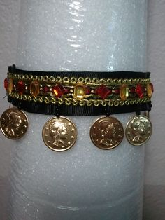 Fancy martingale with gems and dangling coins.